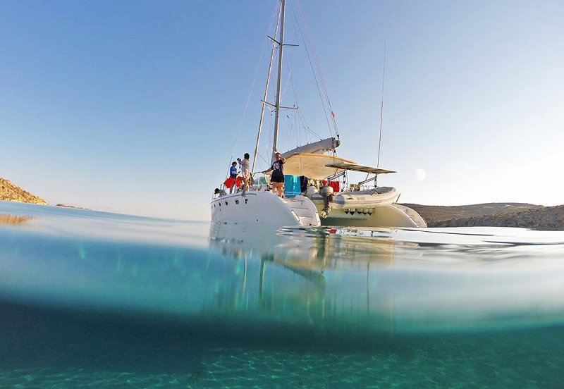 Sailing on a catamaran on a Greek charter yacht